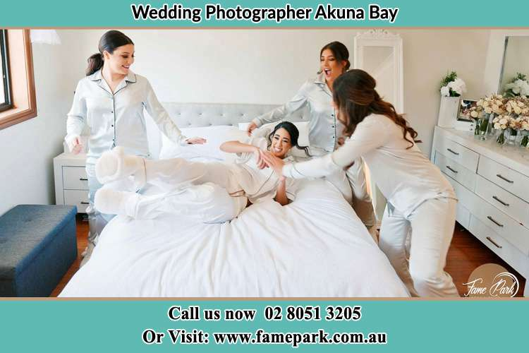 Photo of the Bride and the bridesmaids playing on the bed Akuna Bay NSW 2084