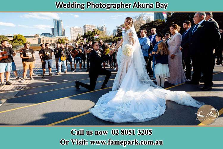 Groom Kneeling down infront of the Bride Akuna Bay NSW 2084
