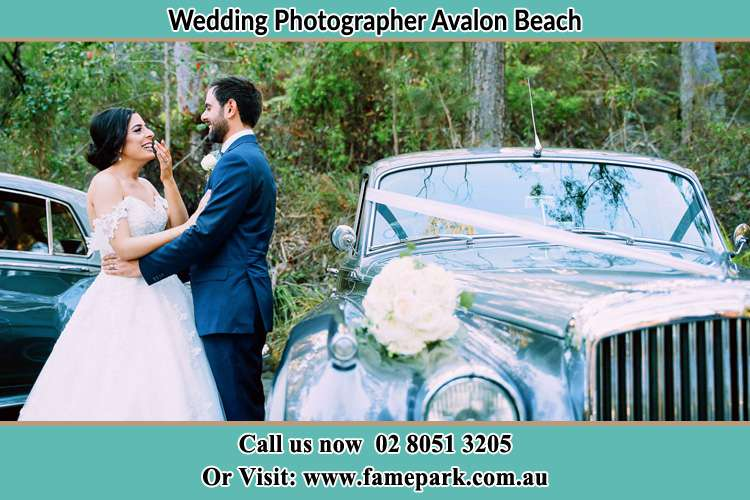 Photo of the Bride and the Groom near the bridal car Avalon Beach NSW 2107