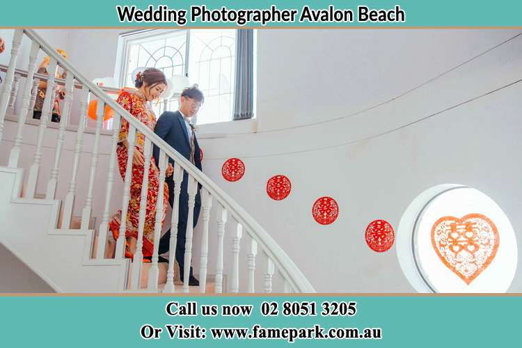 Photo of the Bride and the Groom going down the stair Avalon Beach NSW 2107