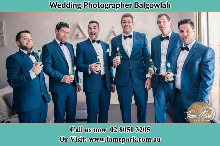The groom and his groomsmen striking a wacky pose in front of the camera Balgowlah NSW 2093
