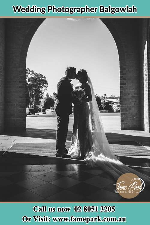 Photo of the Groom and the Bride kissing at the front of the church Balgowlah NSW 2093