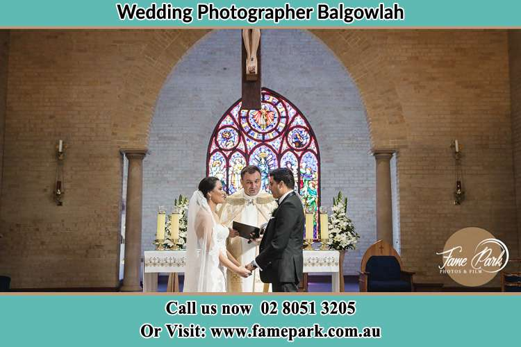 Photo of the Bride and the Groom with the Priest at the altar Balgowlah NSW 2093