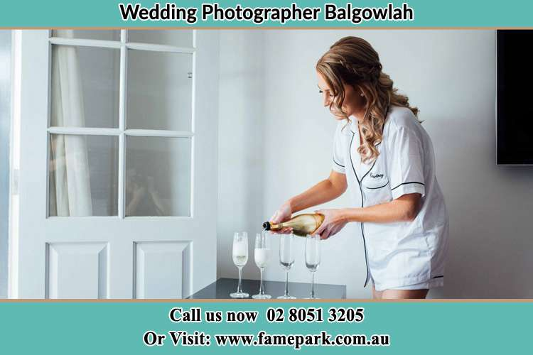 Photo of the Bride pouring wine to the glasses Balgowlah NSW 2093