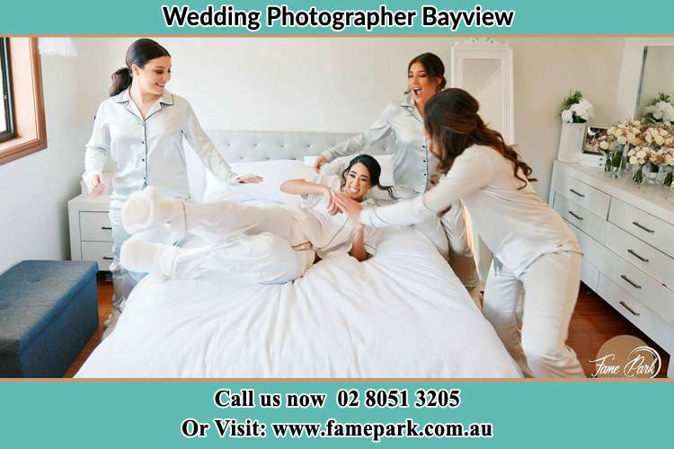 Photo of the Bride and the bridesmaids playing on bed Bayview NSW 2104