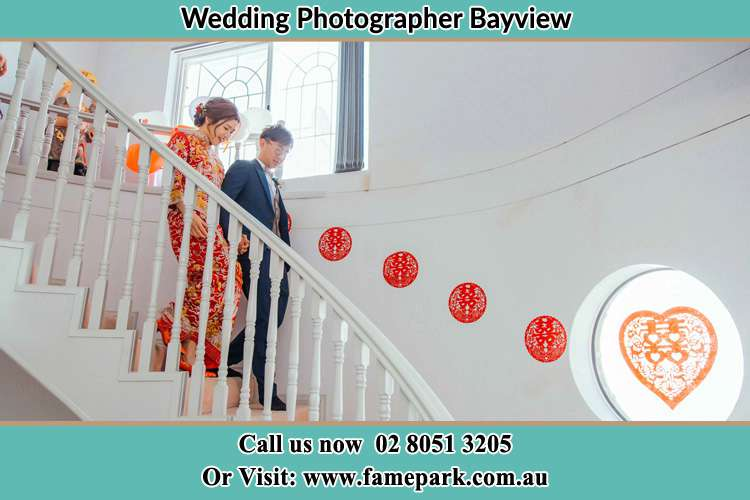 Photo of the Bride and the Groom going down the stair Bayview NSW 2104