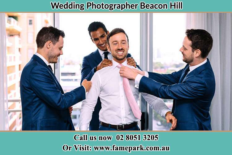 Photo of the Groom helping by the groomsmen getting ready Beacon Hill NSW 2100