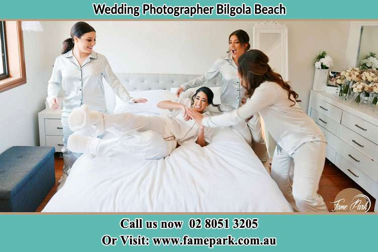 Photo of the Bride and the bridesmaids playing on bed Bilgola Beach NSW 2107