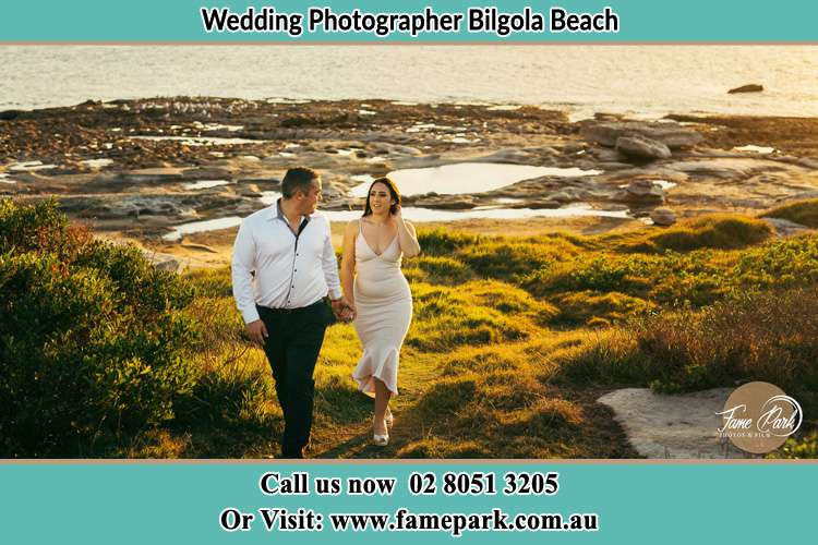Photo of the Groom and the Bride holding hand near the lake Bilgola Beach NSW 2107