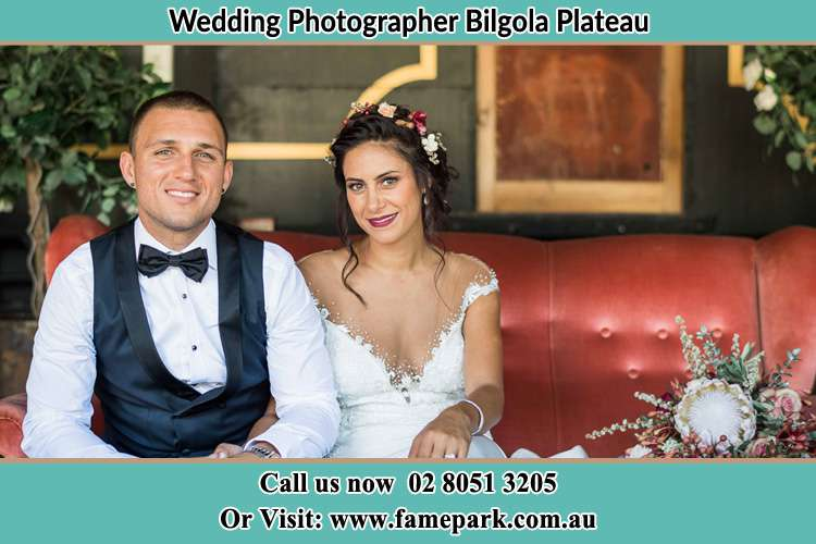 The Groom and the Bride sitting and smiling on camera Bilgola Plateau NSW 2107