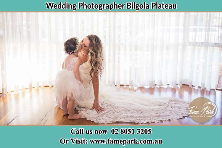 Photo of the Bride kiss the flower girl Bilgola Plateau NSW 2107
