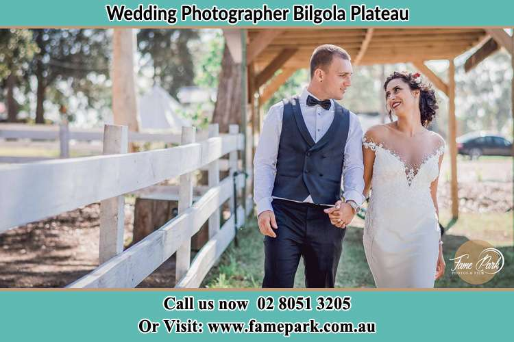 Photo of the Groom and the Bride holding hands while walking Bilgola Plateau NSW 2107