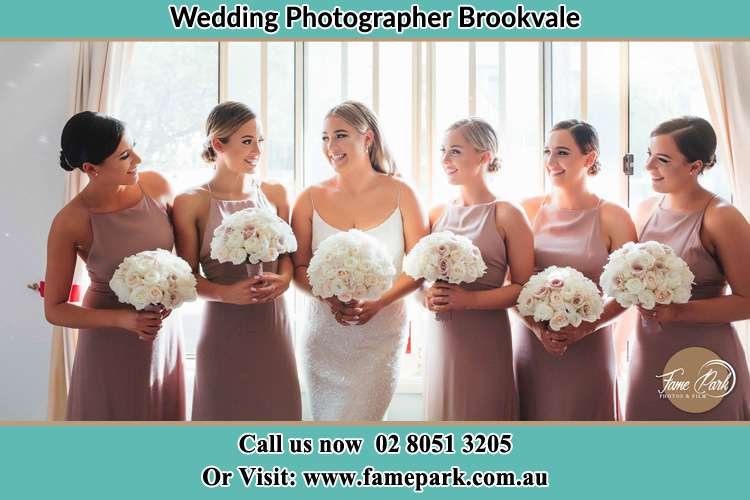 Photo of the Bride and the bridesmaids holding the bouquet of flower Brookvale NSW 2100