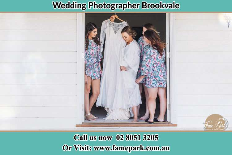 Photo of the Bride and the bridesmaids checking the wedding at the door Brookvale NSW 2100