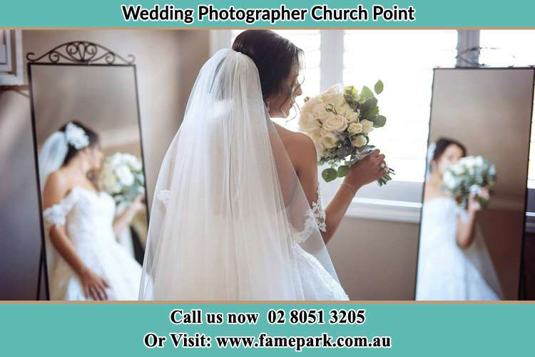 Photo of the Bride holding flower in front of the mirrors Church Point NSW 2105