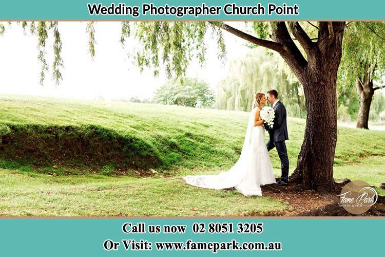 Photo of the Bride and the Groom kissing under the tree Church Point NSW 2105