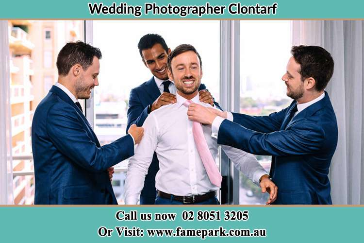 Photo of the Groom help by the groomsmen preparing for the ceremony Clontarf NSW 2093