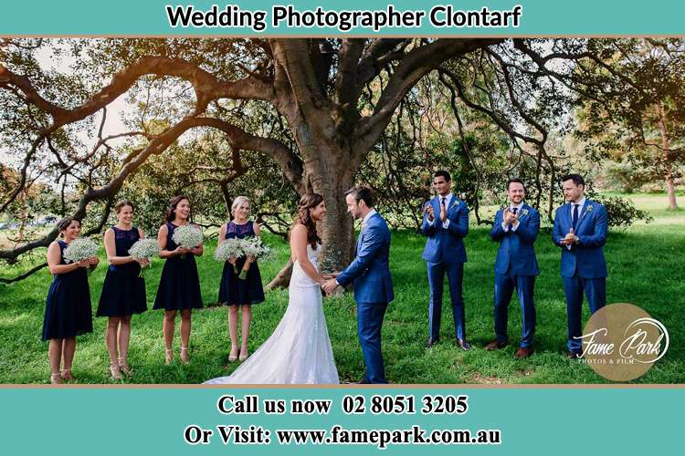 Photo of the Groom and the Bride looking each other with the entourage Clontarf NSW 2093