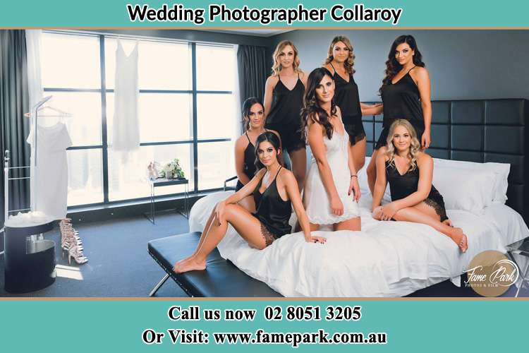 Photo of the Bride and the bridesmaids wearing lingerie on bed Collaroy NSW 2097