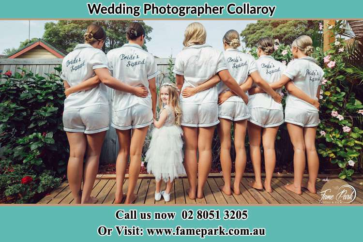 Behind photo of the Bride and the bridesmaids with the flower girl looking back Collaroy NSW 2097