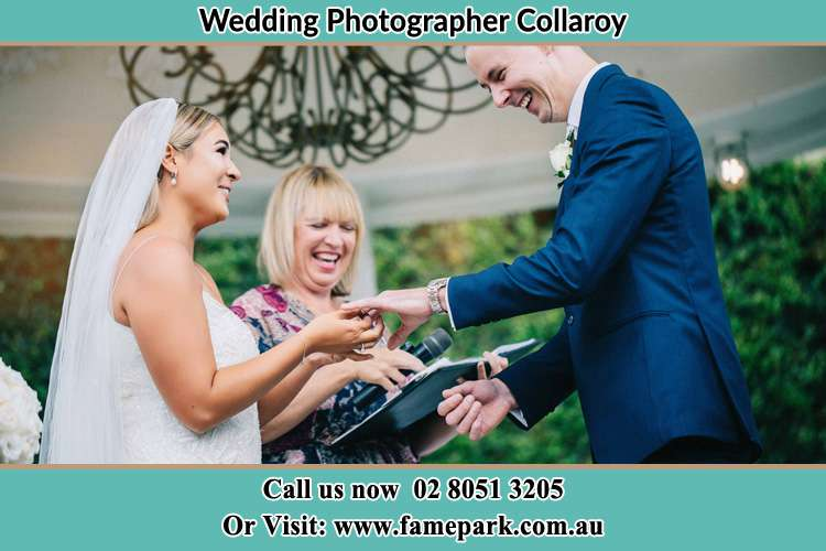 Photo of the Bride wearing ring to the Groom Collaroy NSW 2097
