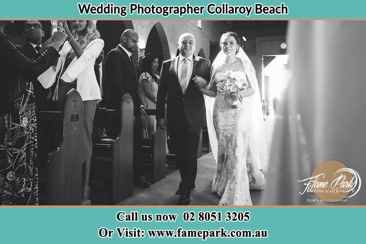 Photo of the Bride with her father walking the aisle Collaroy Beach NSW 2097