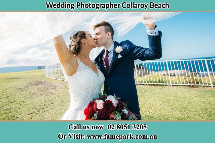 Photo of the Groom and the Bride kissing Collaroy Beach NSW 2097