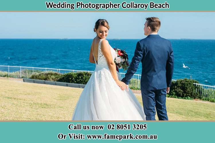 Photo of the Bride and the Groom holding hands at the yard Collaroy Beach NSW 2097