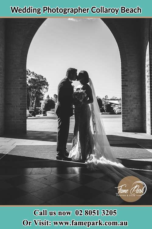 Photo of the Groom and the Bride kissing at the front of the church Collaroy Beach NSW 2097