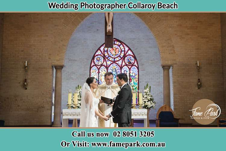 Photo of the Bride and the Groom with the Priest at the altar Collaroy Beach NSW 2097