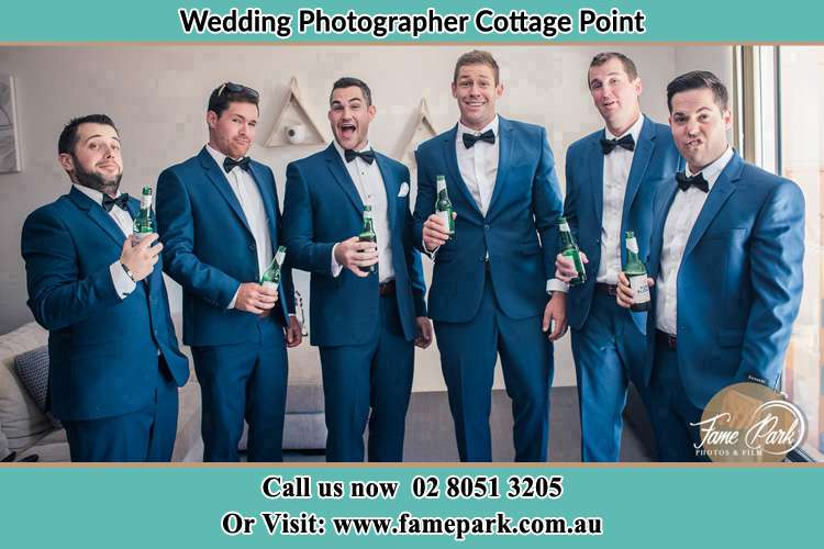 The groom and his groomsmen striking a wacky pose in front of the camera Cottage Point NSW 2084
