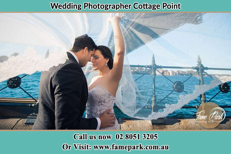 Photo of the Groom and the Bride kissing Cottage Point NSW 2084