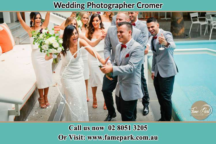 Photo of the Bride and the Groom celebrating with the secondary sponsor Cromer NSW 2099