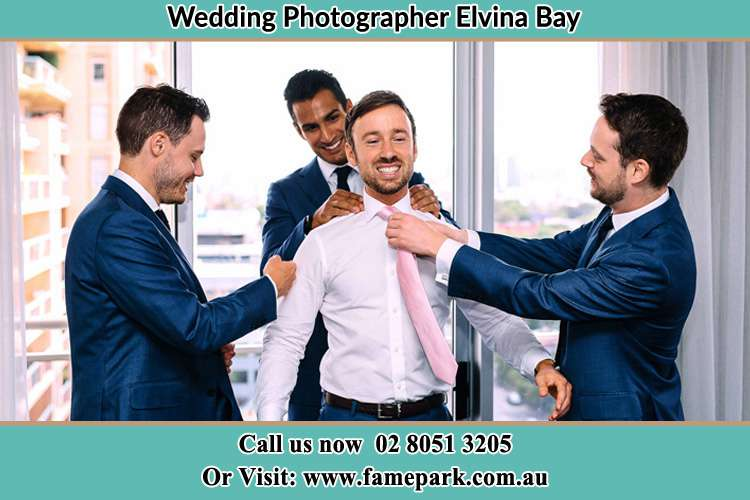 Photo of the Groom helping by the groomsmen getting ready Elvina Bay NSW 2105
