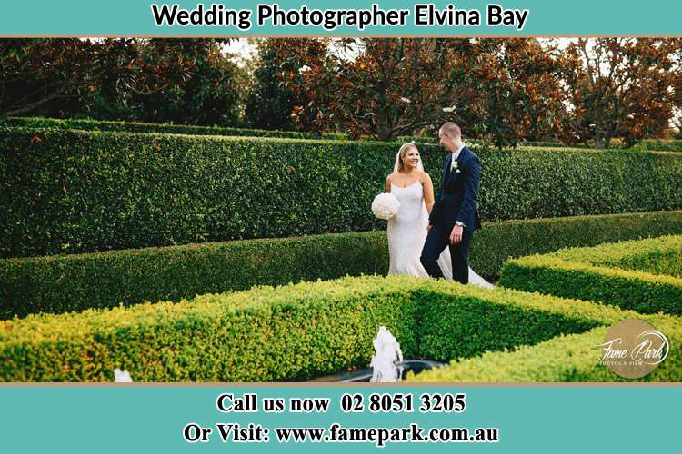 Photo of the Bride and the Groom walking at the garden Elvina Bay NSW 2105
