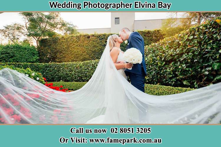 Photo of the Bride and the Groom kissing at the garden Elvina Bay NSW 2105