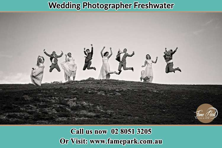 Jump shot photo of the Bride and the Groom with the entourage Freshwater NSW 2096