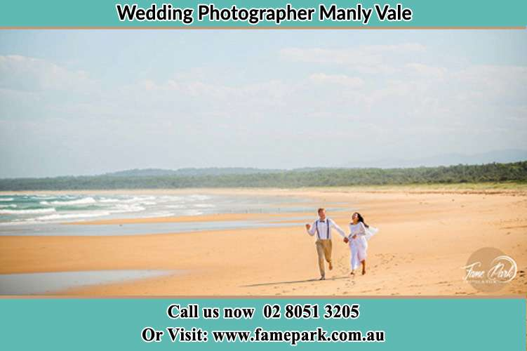 Photo of the Groom and the Bride walking near the sea shore Manly Vale NSW 2093