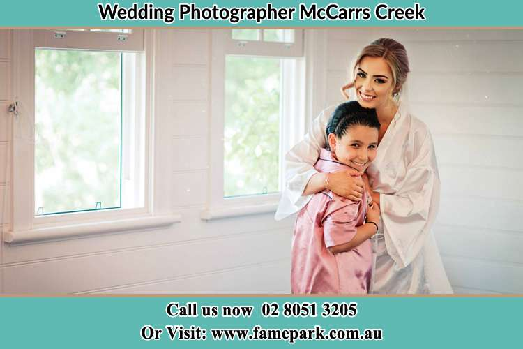 Photo of the Bride hugging the flower girl McCarrs Creek NSW 2105