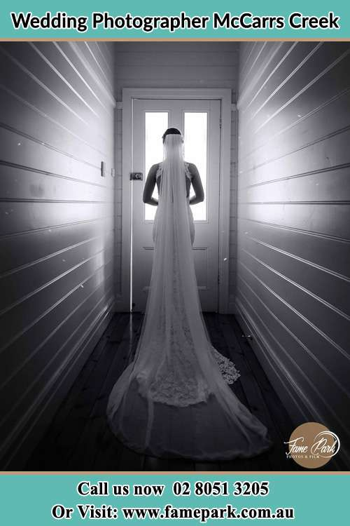 Photo of the Bride going out the door McCarrs Creek NSW 2105