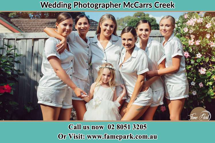 Photo of the Bride and the bridesmaids with the flower girl McCarrs Creek NSW 2105