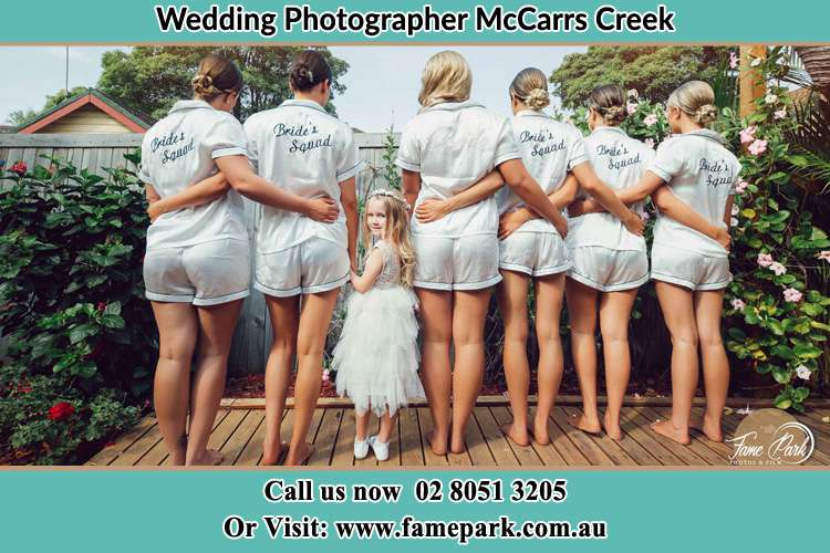 Behind photo of the Bride and the bridesmaids with the flower girl looking back McCarrs Creek NSW 2105