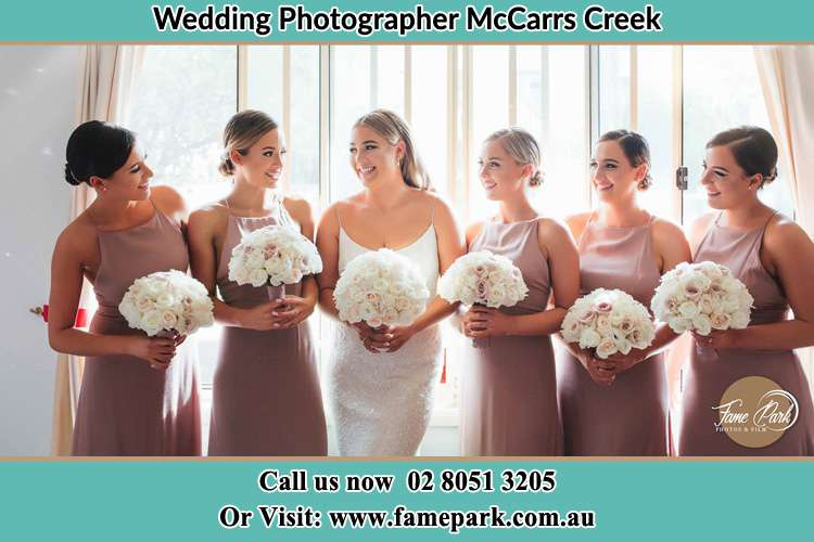 Photo of the Bride and the bridesmaids holding flower bouquet McCarrs Creek NSW 2105