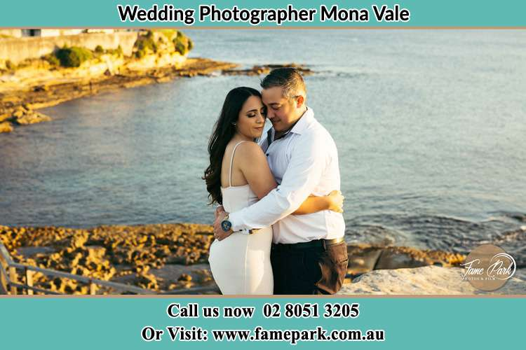 Photo of the Bride and the Groom hugging near the lake Mona Vale NSW 2103