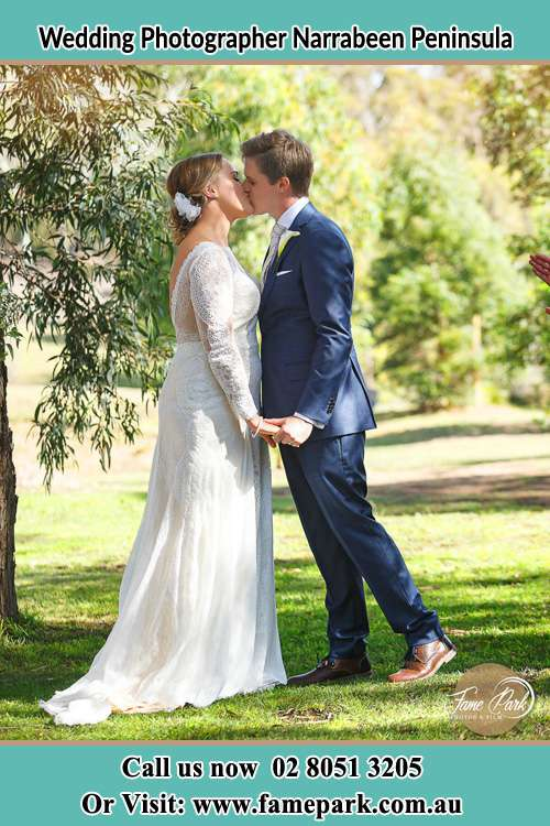 Photo of the Bride and the Groom kissing at the yard Narrabeen Peninsula NSW 2101