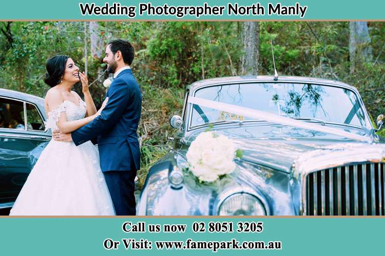 Photo of the Bride and the Groom besides the bridal car North Manly Beach NSW 2100