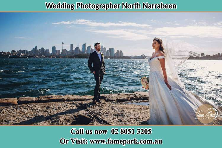 Photo of the Groom and the Bride near the sea front North Narrabeen Beach NSW 2101