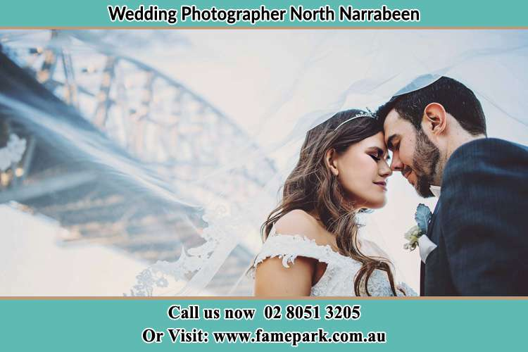 Close up photo of the Bride and the Groom under the bridge North Narrabeen Beach NSW 2101