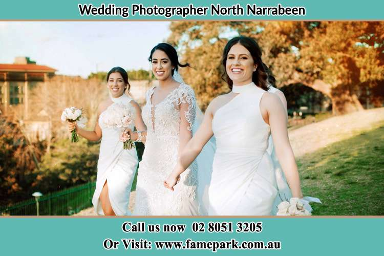 Photo of the Bride and the bridesmaids walking North Narrabeen Beach NSW 2101