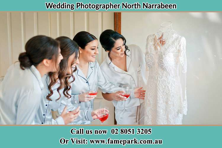 Photo of the Bride and the bridesmaids checking the bridal gown North Narrabeen Beach NSW 2101